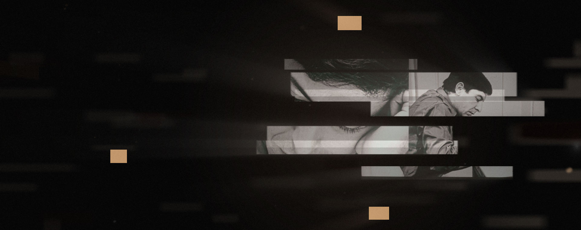 Colour image. On a black background, two superimposed black-and-white images of Leonard Cohen in close-up.